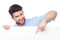 Man pointing at blank poster Royalty Free Stock Photos