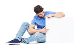 Man pointing at blank sign Stock Photos