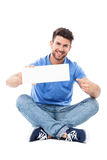 Man pointing at blank sign Royalty Free Stock Images