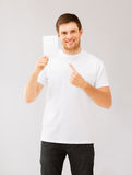 Man pointing at blank white paper. Picture of man pointing at blank white paper Royalty Free Stock Photos