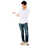 Man pointing with both hands Stock Photo