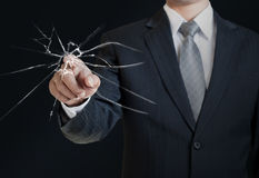 Man pointing on the broken glass Stock Photography