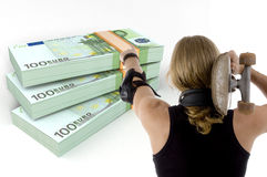 Man pointing the bundles of euro note Royalty Free Stock Photography