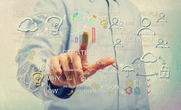 Man pointing at business strategy concepts. Young man pointing at business strategy concepts Stock Image