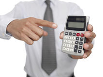 Man pointing at calculator Royalty Free Stock Photography