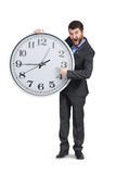 Man pointing at clock Royalty Free Stock Photography