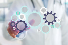 Man pointing a cogwheel interface setting - Technology concept Royalty Free Stock Photo