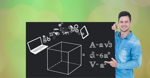 Man pointing at diagrams and formulas on bill board. Digital composite of Man pointing at diagrams and formulas on bill board Stock Image