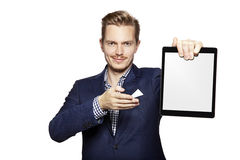 Man pointing at digital tablet Stock Images
