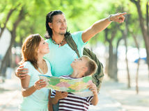Man pointing the direction  for family Stock Photos