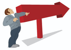 Man is pointing in the direction of a red arrow. Sign Royalty Free Stock Photography