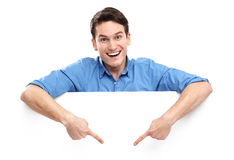 Man pointing down at empty whiteboard Royalty Free Stock Photo