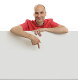 Man pointing at empty board Royalty Free Stock Images