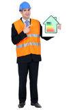 Man pointing at energy rating Stock Photo