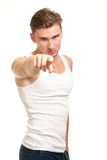 Man Pointing finger. Male model pointing finger with blond hair and white shirt. concept - you can be next Stock Images