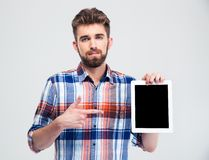 Man pointing finger on blank tablet computer screen Royalty Free Stock Photo