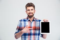 Man pointing finger on blank tablet computer screen is Stock Image