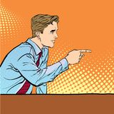 A man pointing a finger. A man explaining something. Speaking man. The man at the podium speaks. Handsome young. Businessman giving advice. Concept idea of Royalty Free Stock Photo