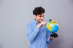 Man pointing finger on globe Royalty Free Stock Photos