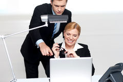 Man pointing finger at laptop screen royalty free stock images