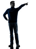 Man pointing finger silhouette full length Stock Photo