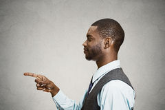Man pointing finger at someone stock photo