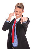 Man pointing with finger while talking on the phone Stock Image