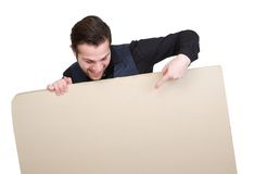 Man pointing finger to blank sign Royalty Free Stock Photos