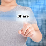Man pointing finger to click share icon. On virtual display Stock Images
