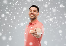 Man pointing finger to you over snow background Royalty Free Stock Photography