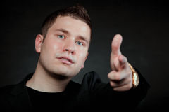 Man pointing a finger towards you Royalty Free Stock Photos
