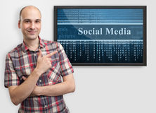 Man pointing finger on tv screen Stock Images