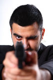 Man pointing gun Stock Images