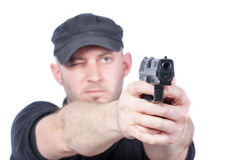 Man pointing gun. Focus on the gun Royalty Free Stock Images