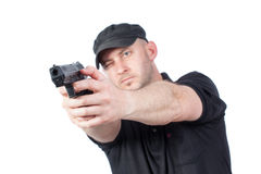 Man pointing gun, isolated. Focus on the gun Stock Photo