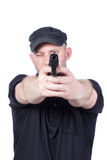 Man pointing gun, isolated. Focus on the gun Royalty Free Stock Photos
