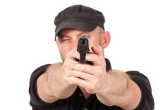 Man pointing gun, isolated. Focus on the gun Royalty Free Stock Image