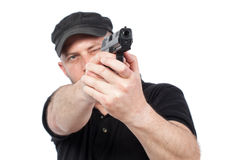 Man pointing gun, isolated. Focus on the gun Royalty Free Stock Images