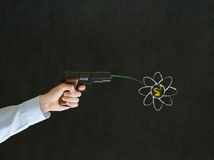 Man pointing a gun with peace flower Royalty Free Stock Photography
