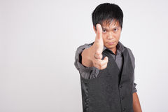 Man pointing handgun at the camera Stock Photo