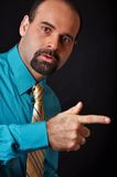 Man pointing his finger. This picture represents a man pointing his finger Royalty Free Stock Image