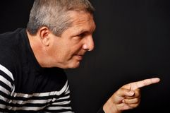 Man pointing his finger. This picture represents a man pointing his finger Stock Photo