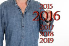 Man pointing 2016 with his finger stock image