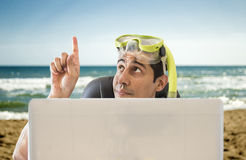 Man pointing his finger to beach Stock Photos