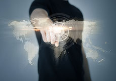 Man pointing his finger at world map Stock Photo