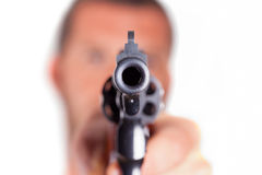 A man pointing his gun revolver. Selectively concentrated on the front of the gun Stock Images