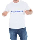 Man pointing at his volunteer tshirt Stock Images