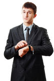 Man pointing at his watch Stock Images