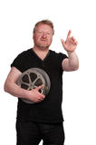 Man pointing, holding film reels Royalty Free Stock Photos