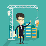 Man pointing at idea bulb hanging on crane. Stock Images